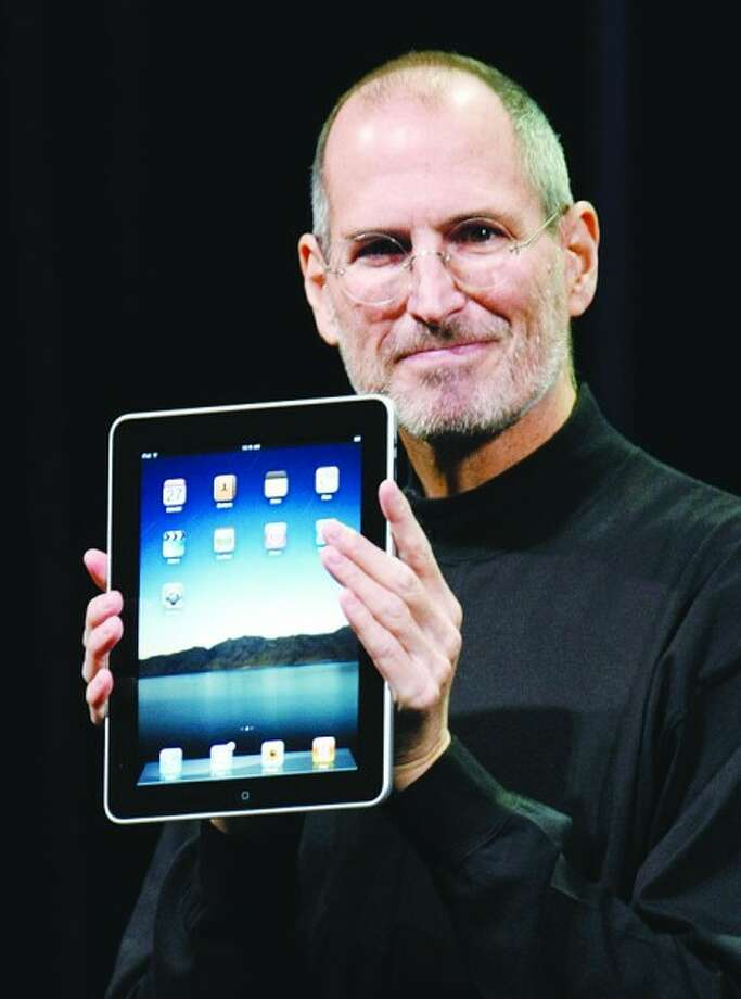 FILE - A Jan. 27, 2010 file photo shows Apple CEO Steve Jobs holding up the new iPad during a product announcement in San Francisco. Jobs sent a note Monday, Jan. 17, 2011 to employees saying he''s taking a medical leave of absence so he can focus on his health. He says he will continue as CEO and be involved in major decisions but has asked Tim Cook to be responsible for all day-to-day operations. (AP Photo/Paul Sakuma, File)