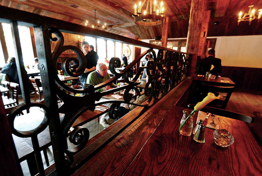 The Little Pub in Wilton features a hand crafted bar and tables to offer the authentic pub feel. Hour photo / Erik Trautmann / (C)2013, The Hour Newspapers, all rights reserved