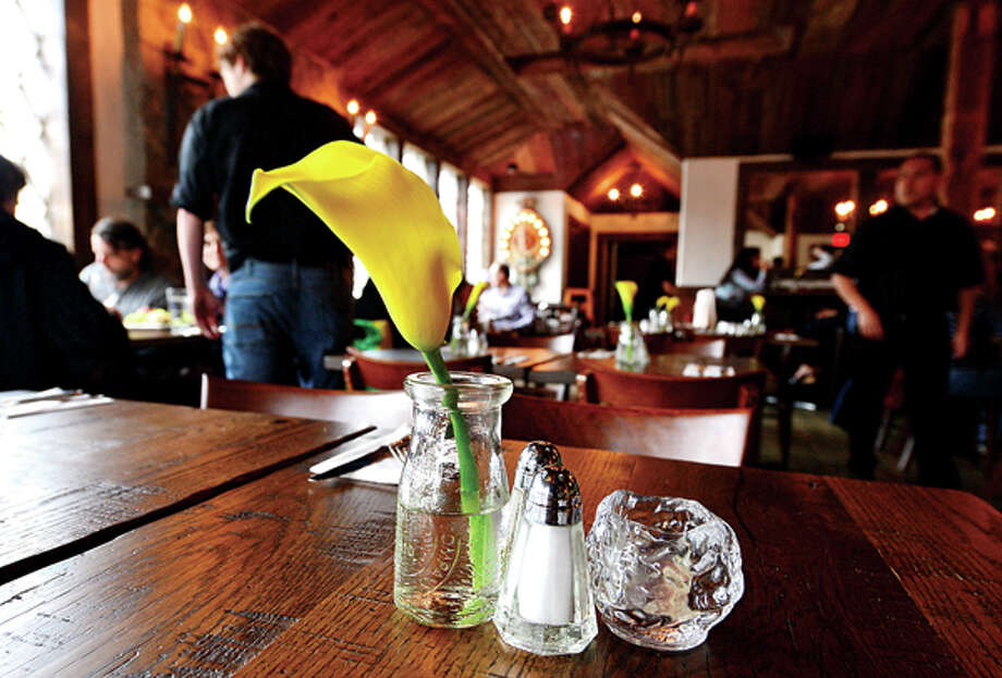 The Little Pub in Wilton features hand crafted bar and tables to offer the authentic pub feel. Hour photo / Erik Trautmann / (C)2013, The Hour Newspapers, all rights reserved