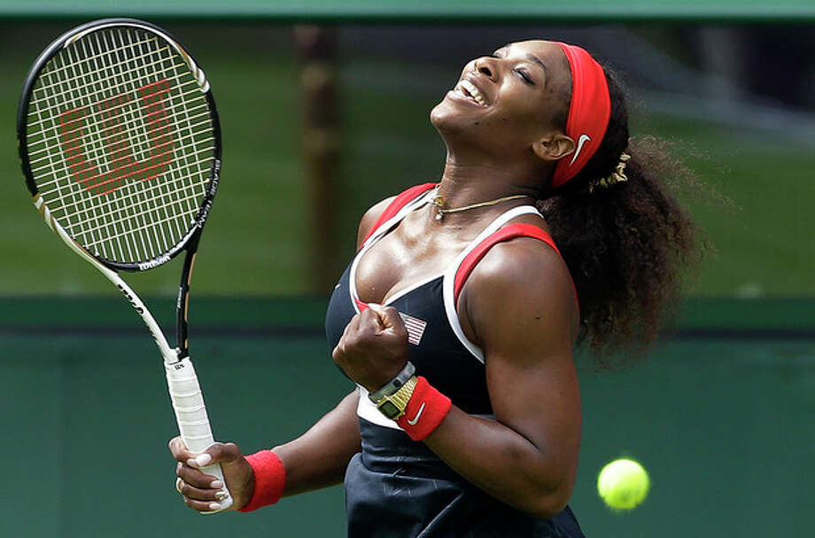Serena Williams of the United States reacts after defeating Jelena Jankovic of Serbia in a first round match at the All England Lawn Tennis Club in Wimbledon, London at the 2012 Summer Olympics, Saturday, July 28, 2012. (AP Photo/Elise Amendola) / AP