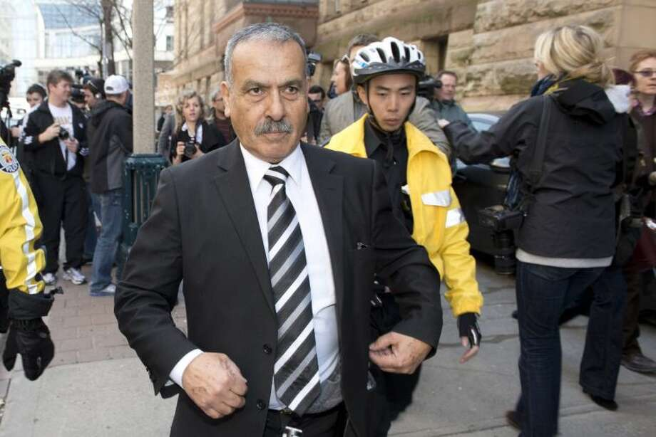 Mohammed Jaser, father of Raed Jaser, leaves court in Toronto on Tuesday, April 23, 2013. Raed Jaser is accused with another man of plotting to derail a train in Canada with support from al-Qaida elements in Iran. Raed Jaser had a brief court appearance and was told to appear in court again next month. (AP Photo/ THE CANADIAN PRESS,Frank Gunn)