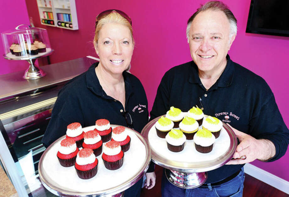 Hour photo / Erik TrautmannFrances and Sky Mercede, owners of Forever Sweet Bakery, shown in their new bakery at 4 New Canaan Ave. / (C)2013, The Hour Newspapers, all rights reserved