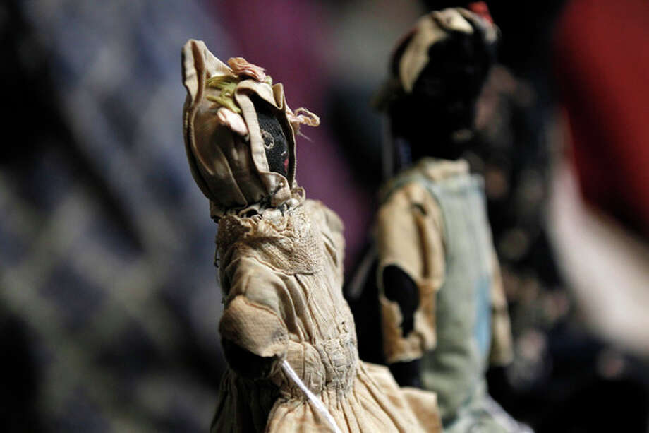 In this Wednesday, July 25, 2012 photo, historic black cloth dolls appear on display in New Orleans. Amid rare antique dolls crafted in porcelain, whimsical Kewpies and homage to contemporary icon Barbie, cloth dolls in the image of African-Americans drew special attention as more than 1,200 collectors gathered in New Orleans for the annual convention of the United Federation of Doll Clubs. (AP Photo/Gerald Herbert) / AP
