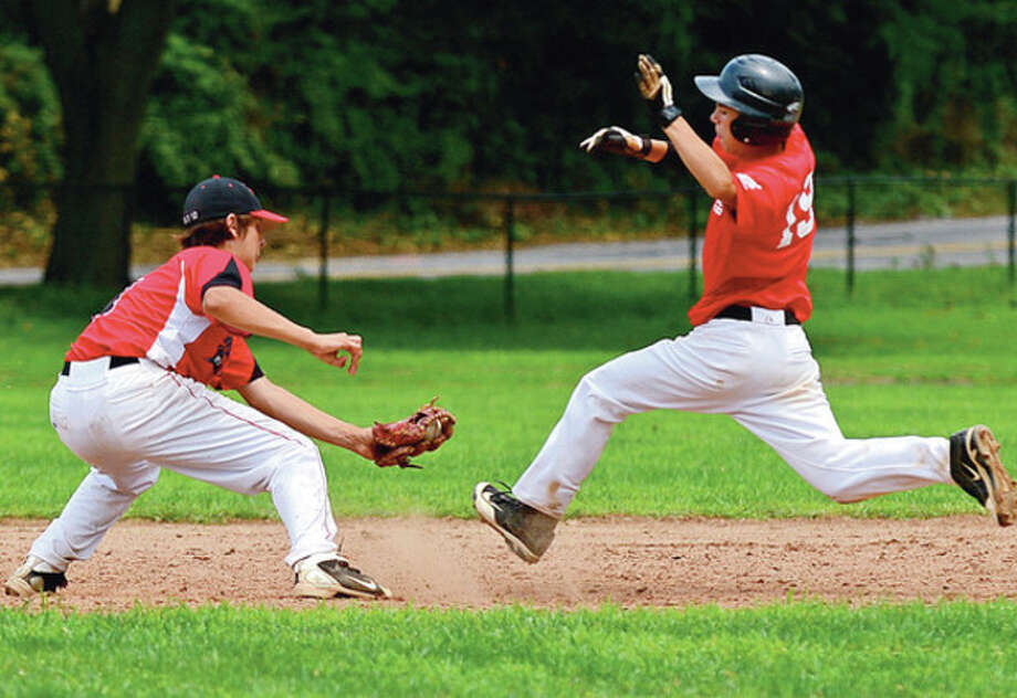 Norwalk Jr. Legion's second baseman Chjris Cotaling gets the tag on Wallingford' Andrew Colantonio during the state tournament opener Saturday.Hour photo / Erik Trautmann / ©2012 The Hour Newspapers