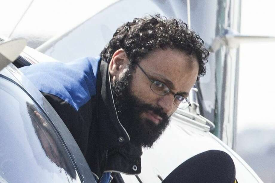 """Chiheb Esseghaier, one of two suspects accused of plotting with al-Qaida in Iran to derail a train in Canada, arrives at Buttonville Airport just north of Toronto, on Tuesday, April 23, 2013. Canadian investigators say Raed Jaser, 35, and his suspected accomplice Esseghaier, 30, received """"directions and guidance"""" from members of al-Qaida in Iran. In a brief court appearance in Montreal Tuesday, Esseghaier declined to be represented by a court-appointed lawyer. He made a brief statement in French in which he called the allegations against him unfair. (AP Photo/The Canadian Press, Chris Young)"""