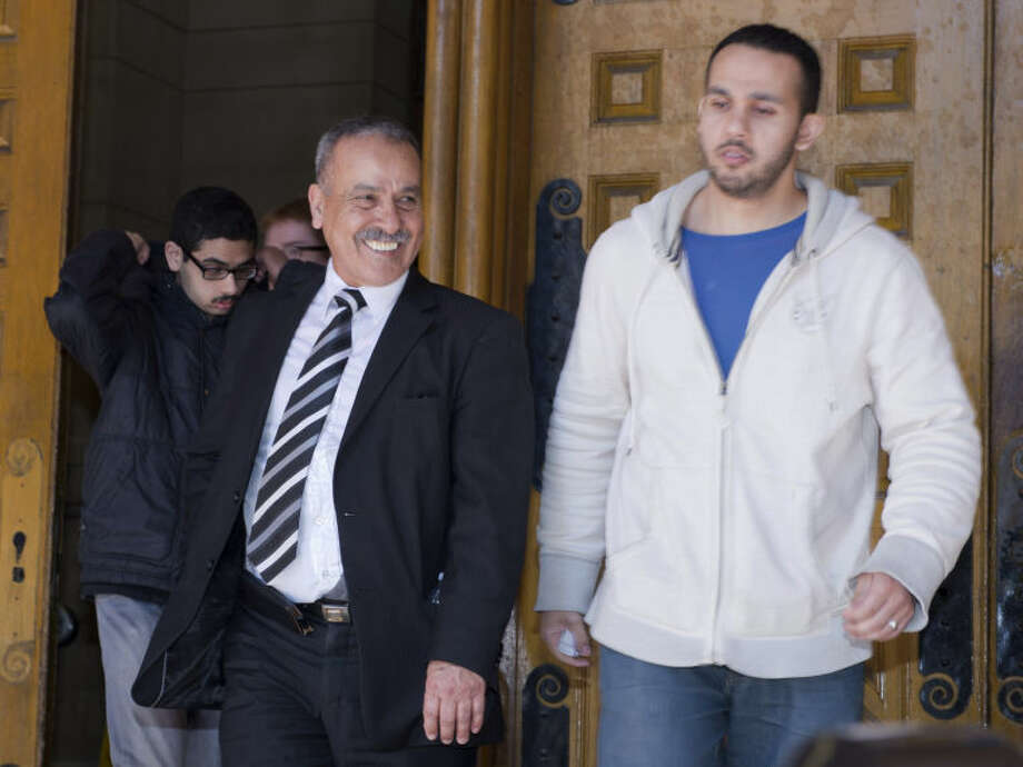 Family members of Raed Jaser, including father Mohammed Jaser, left, leave court in Toronto on Tuesday, April 23, 2013. Jaser, accused with another of plotting to derail a train in Canada with support from al-Qaida elements in Iran, made a brief court appearance and was told to appear in court again next month. (AP Photo/The Canadian Press, Frank Gunn)