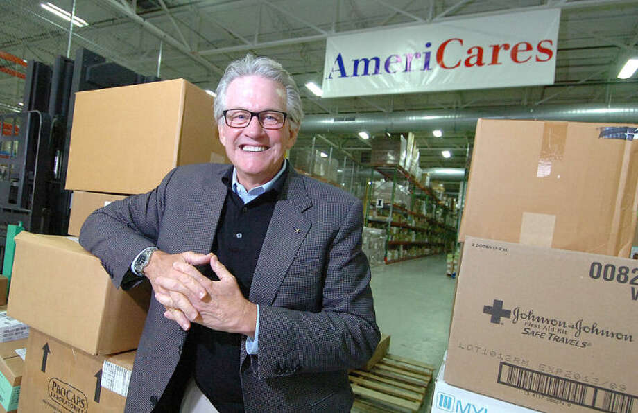 Hour Photo/Alex von Kleydorff . AmeriCares President and CEO Curt Welling with medical supplies ready for shipment from the companies warehouse