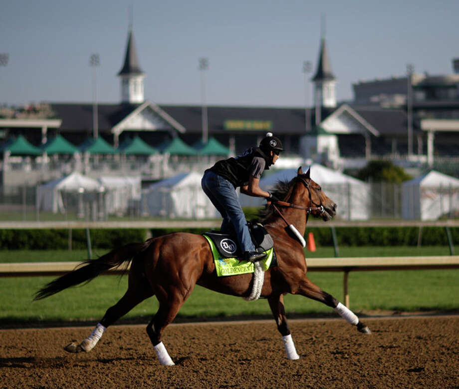 Exercise rider Jonny Garcia rides Kentucky Derby hopeful Goldencents for a workout at Churchill Downs Tuesday, April 30, 2013, in Louisville, Ky. (AP Photo/David Goldman) / AP