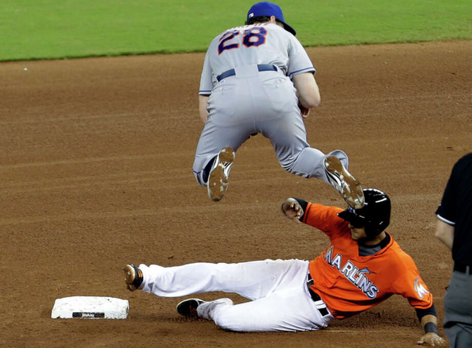 Miami Marlins' Donovan Solano, right, is out at second as New York Mets second baseman Daniel Murphy (28) throws to first to complete a double play in the fourth inning during a baseball game, Tuesday, April 30, 2013, in Miami. (AP Photo/Lynne Sladky) / AP