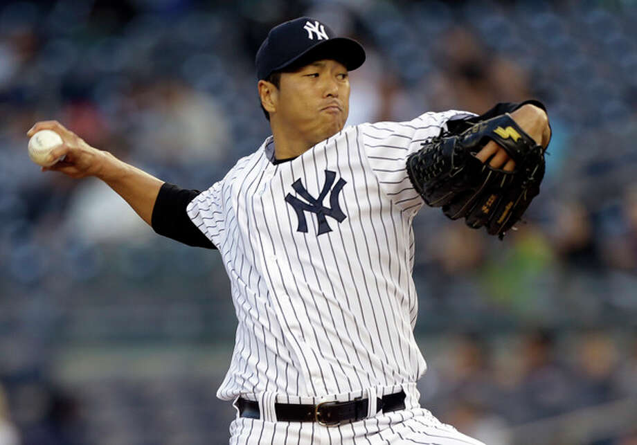 New York Yankees starting pitcher Hiroki Kuroda winds up against the Houston Astros in the first inning of a baseball game at Yankee Stadium in New York, Tuesday, April 30, 2013. (AP Photo/Kathy Willens) / AP