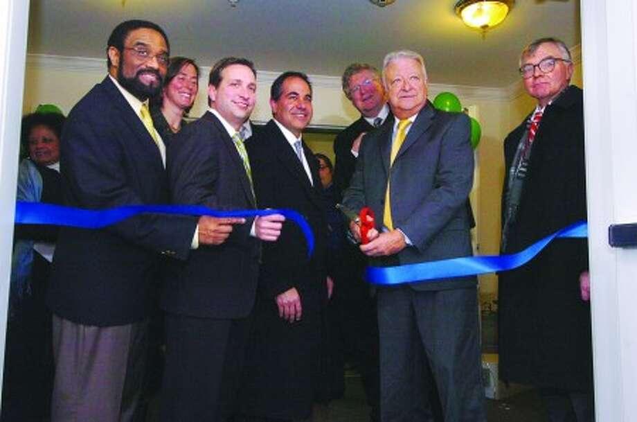 Photo/Alex von Kleydorff Mayor Richard Moccia cuts the ribbon opening 80 Fair St, new affordable rental housing in Norwalk.