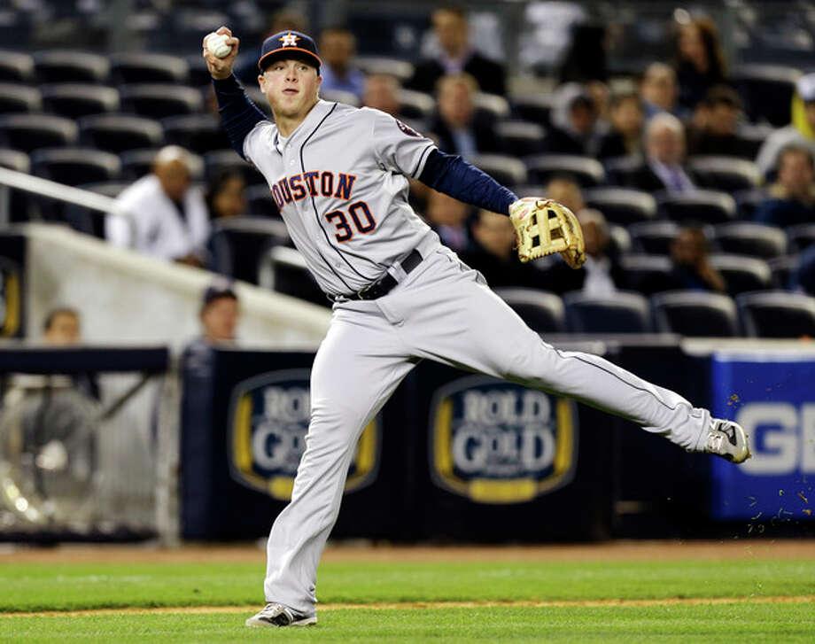 Houston Astros third baseman Matt Dominguez (30) fields New York Yankees' Ichiro Suzuki's fifth-inning infield single in a baseball game at Yankee Stadium in New York, Tuesday, April 30, 2013. (AP Photo/Kathy Willens) / AP