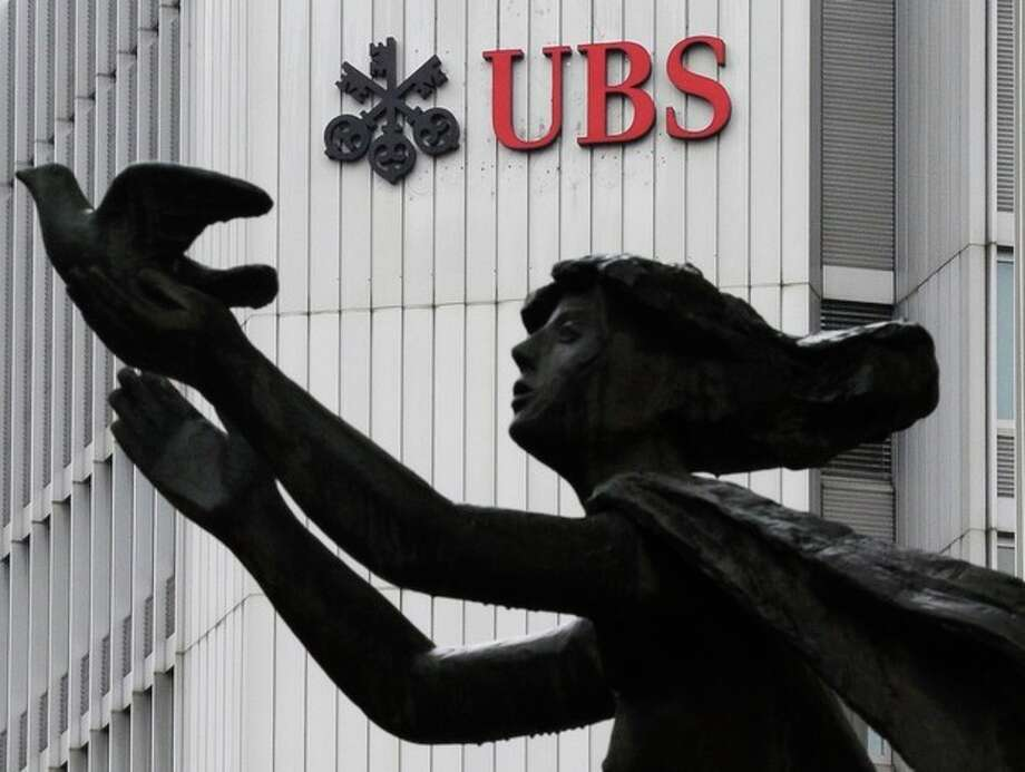 FILE - The March 19, 2012 file photo shows the logo of Swiss bank UBS in Zurich, Switzerland. A first-quarter net profit of US$ 1 billion thanks to strong investment banking and wealth management sent shares in Swiss bank UBS AG up 5 percent Tuesday morning, April 30, 2013, on the Swiss stock exchange. The result posted by Switzerland's biggest bank, headquartered in Zurich and Basel, Switzerland, caused shares to jump to 16.5 francs soon after trading began. (AP Photo/Keystone, Steffen Schmidt) / Keystone