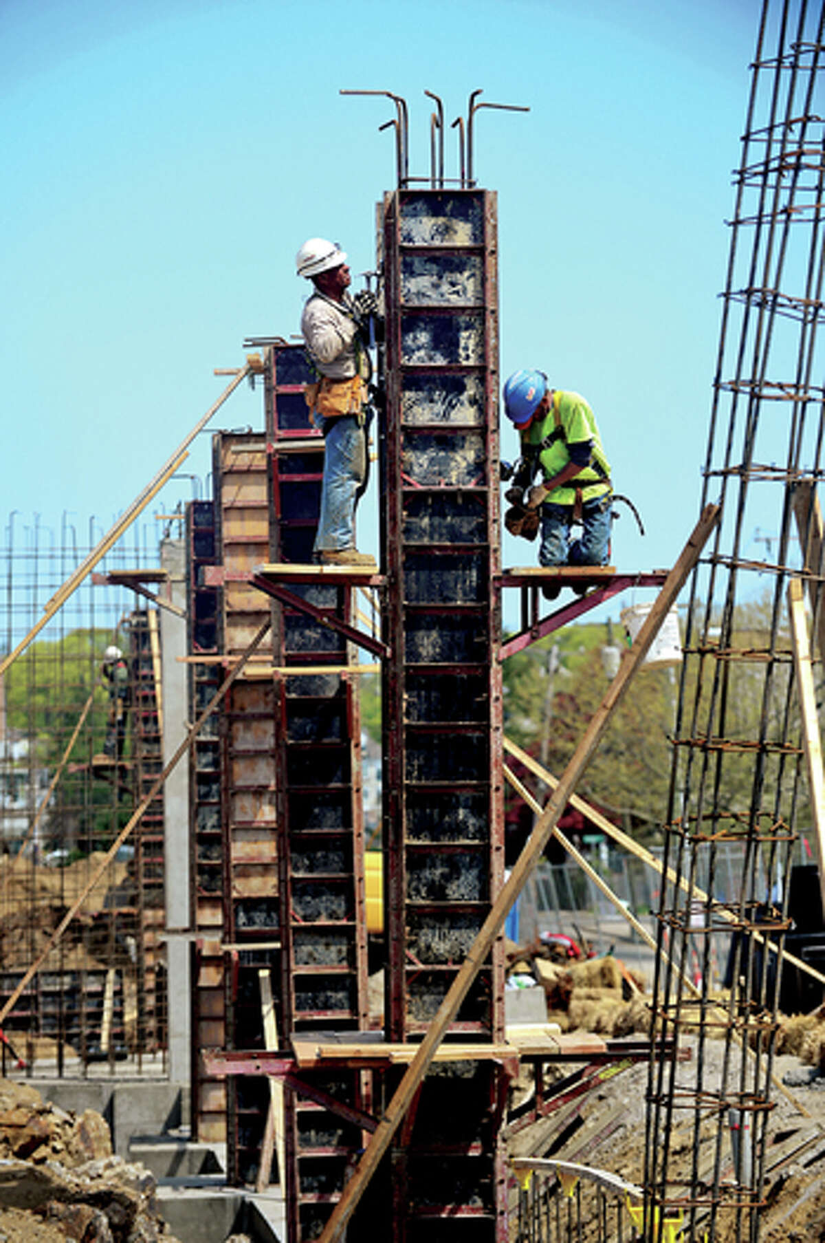 Workers build pillars for the Waypointe development along West Ave in Norwalk Tuesday. Hour photo / Erik Trautmann