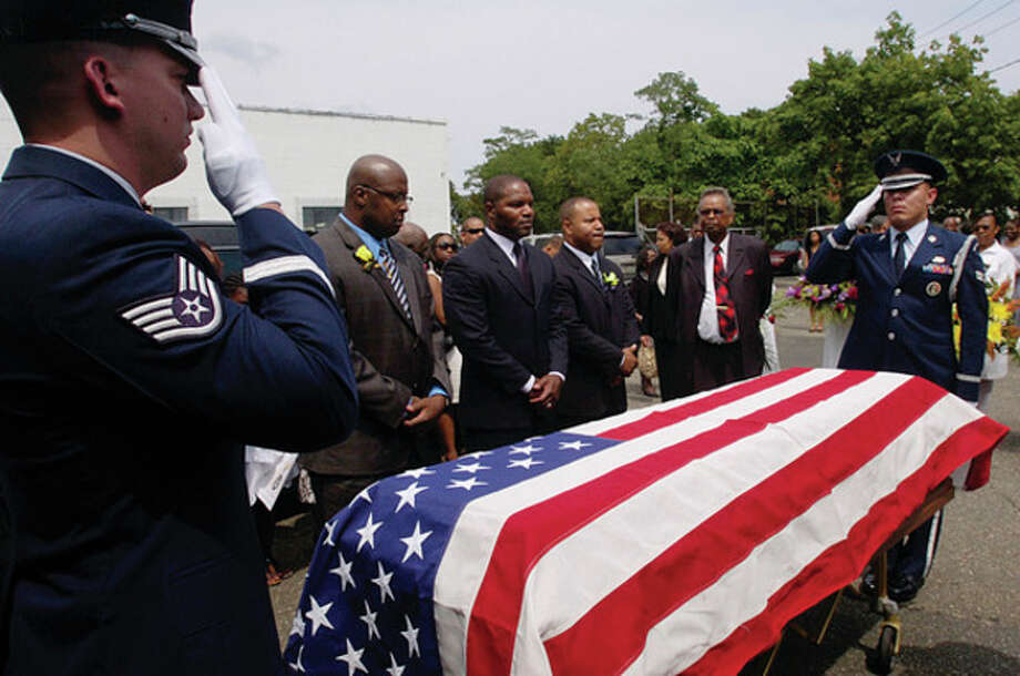 Hundreds turned out for the funeral service for Richard Fuller Sr., a air force veteran, Saturday who was given full military honors. / (C)2011, The Hour Newspapers, all rights reserved