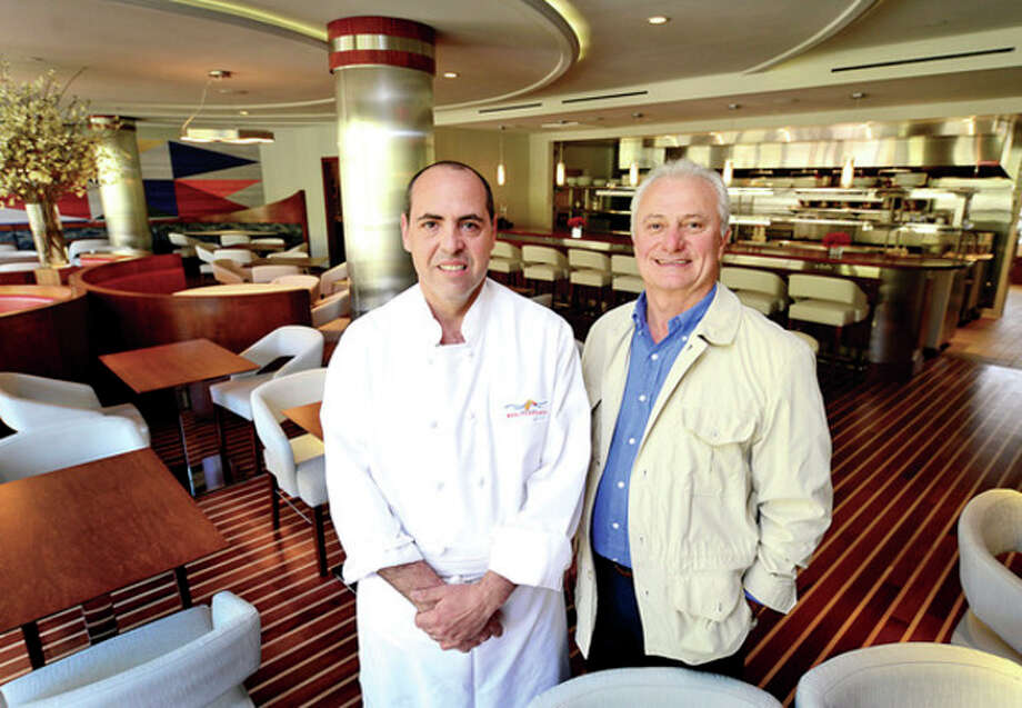 Hour photo / Erik TrautmannChef Albert DeAngelis and owner Ramza Zakka of Mediterraneo restaurant at Hotel Zero Degrees, which features views of the Norwalk River, opened for dinner Monday and will be open for lunch this coming Monday. / (C)2013, The Hour Newspapers, all rights reserved