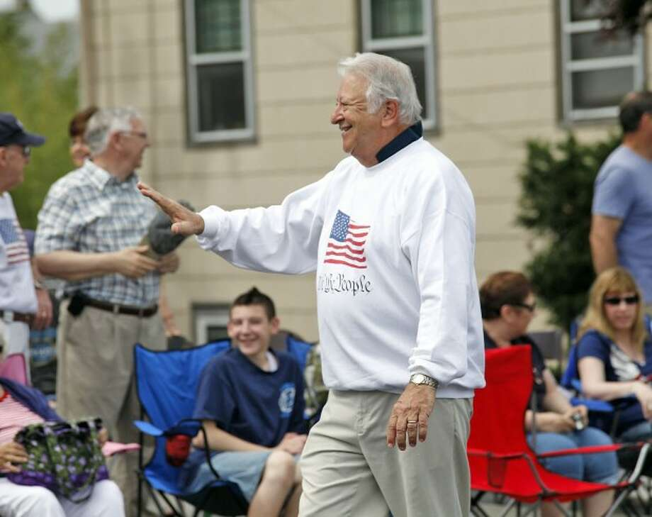 Mayor Moccia waves to a crowd during Norwalk''s annual Memorial Day Parade Monday morning. Hour Photo / Danielle Robinson