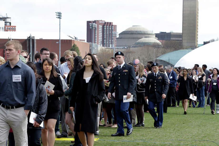People arrive to a memorial service for fallen Massachusetts Institute of Technology campus officer Sean Collier at MIT in Cambridge, Mass. Wednesday, April 24, 2013. Authorities say Collier was killed by the Boston Marathon bombing suspects last Thursday, April 18. He had worked for the department a little more than a year. Vice President Joe Biden, MIT President L. Rafael Reif, police chief John DiFava and members of Collier's family are scheduled to speak. (AP Photo/Elise Amendola) / AP