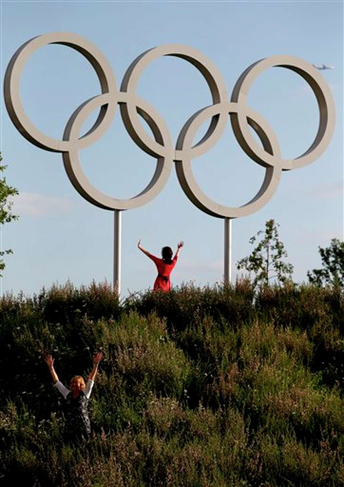 Mandy Burrell, bottom left, poses near the Olympic rings at the Olympic Park during the 2012 Summer Olympics, Saturday, July 28, 2012, in London. (AP Photo/Jae C. Hong)