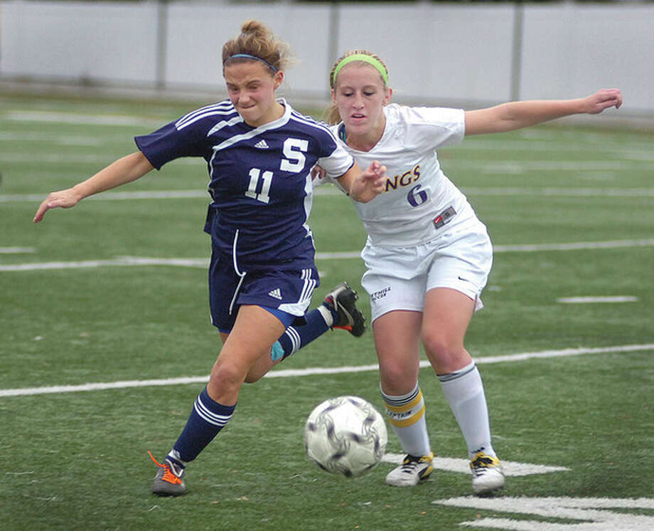 Photo by Alex von Kleydorff Staples High School's Ali Crofts, left, battles Westhill's Dana Johnson for possession of the ball during Tuesday's Class L playoff game in Stamford. / 2011 The Hour Newspapers