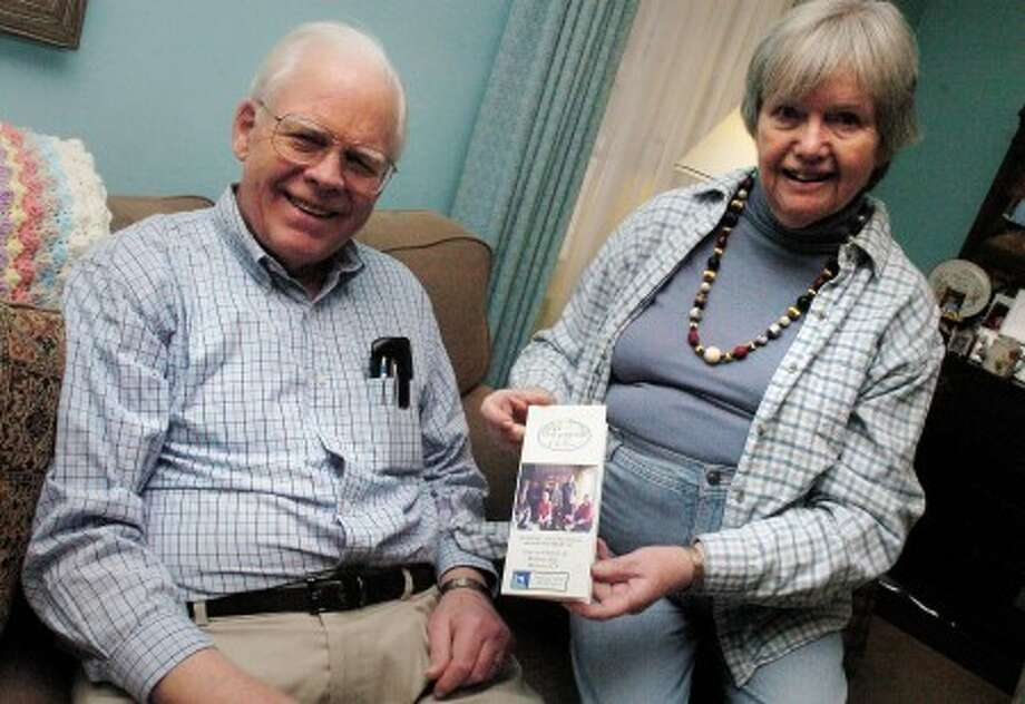 Phil Richards and his wife Anne with their brochure on Stay at Home Wilton for seniors. photo/matthew vinci