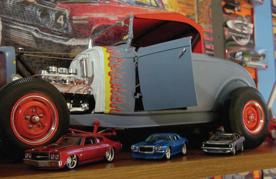 Hour photo / Erik Trautmann Norwalk resident Rick Vitatoe has a toy car collection of over 3000 cars. / (C)2011, The Hour Newspapers, all rights reserved