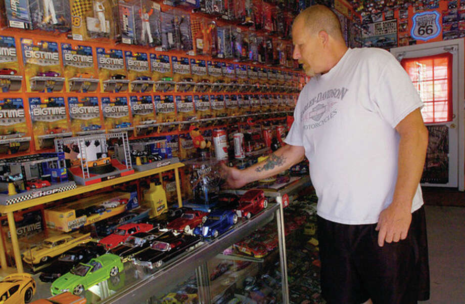 Norwalk resident Rick Vitatoe has a toy car collection of over 3000 race cars. / (C)2011, The Hour Newspapers, all rights reserved