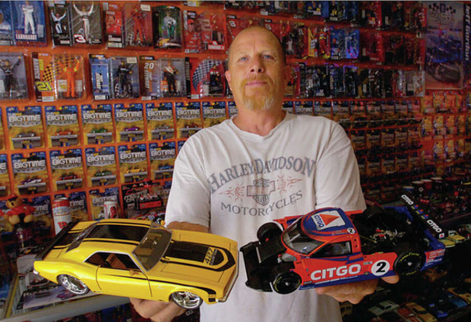 Hour photo / Erik Trautmann Norwalk resident Rick Vitatoe has a toy car collection of over 3000 race cars. / (C)2011, The Hour Newspapers, all rights reserved