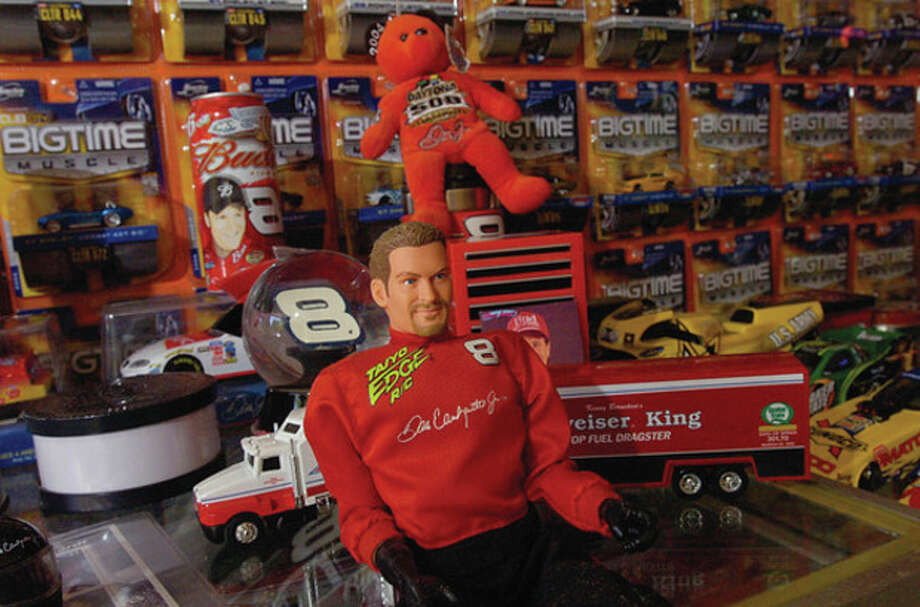 Norwalk resident Rick Vitatoe has a toy car collection of over 3000 race car, figures and other memoribilia / (C)2011, The Hour Newspapers, all rights reserved