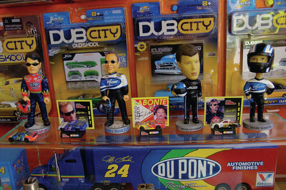Norwalk resident Rick Vitatoe has a toy car collection of over 200 race cars, figures and other racing memoribilia. / (C)2011, The Hour Newspapers, all rights reserved