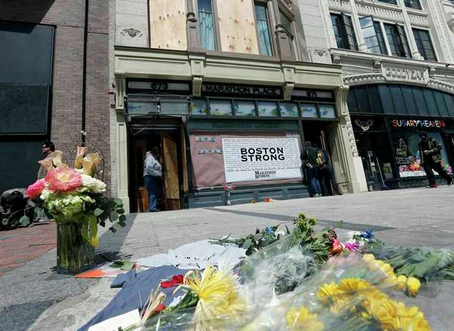 A makeshift memorial sits at the spot where the first bomb detonated on April 15 near the finish line of the Boston Marathon on Boylston Street in Boston, Wednesday, April 24, 2013. Traffic was allowed to flow all the way down Boylston Street on Wednesday morning for the first time since two explosions on April 15. (AP Photo/Michael Dwyer) / AP