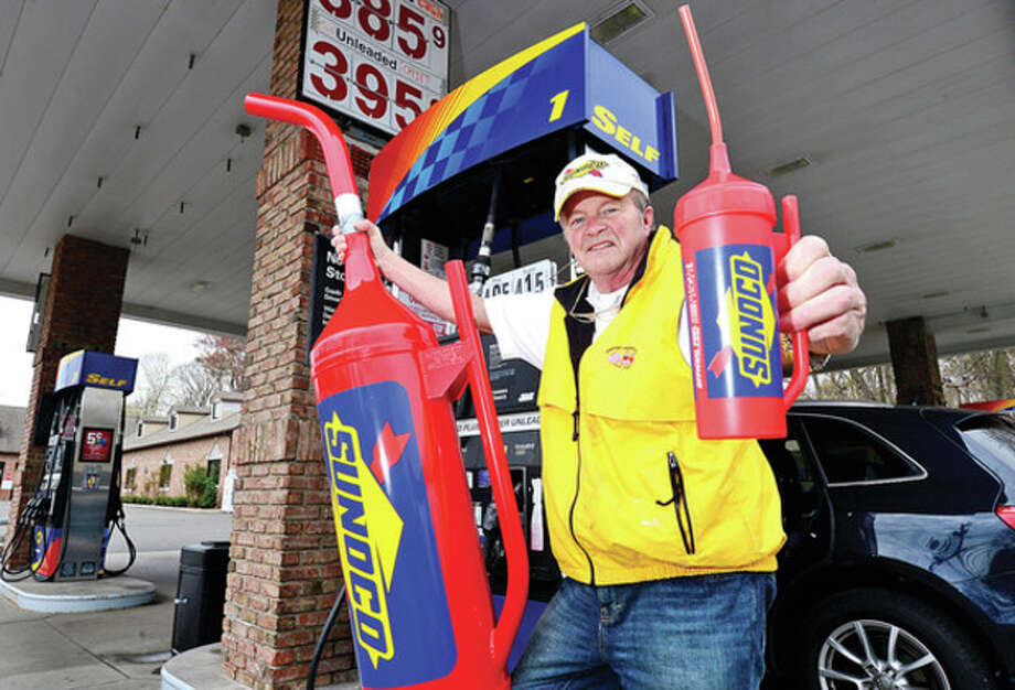 Norwalker Bob Basche has developed a water bottle designed the same as the iconic Sunoco NASCAR fuel can.Hour photo / Erik Trautmann / (C)2013, The Hour Newspapers, all rights reserved