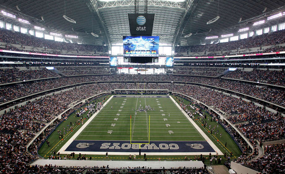 FILE - In this Oct. 23, 2011, file photo, fans cheer as the St. Louis Rams and Dallas Cowboys play in an NFL football game at Cowboys Stadium in Arlington, Texas. A person familiar with the decision tells The Associated Press that Arlington, Texas, has beaten out Tampa, Fla., in the bidding to be the site of the first title game in the new playoff system. The game will be Jan. 12, 2015. (AP Photo/Sharon Ellman, File) / FR170032AP