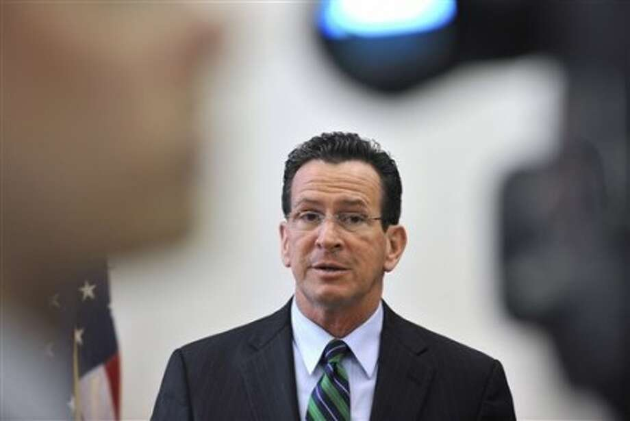 Connecticut Gov. Dannel P. Malloy holds his first news conference as governor in his office at the Capitol in Hartford, Conn., Thursday, Jan. 6, 2011. (AP Photo/Jessica Hill)