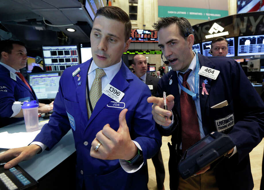 Specialist Joseph Mastrolia, left, and trader Gregory Rowe, work on the floor of the New York Stock Exchange Wednesday, April 24, 2013. Stock indexes are little changed in early trading on Wall Street following mixed earnings results from Apple, Ford, Boeing and other major U.S. companies. (AP Photo/Richard Drew) / AP