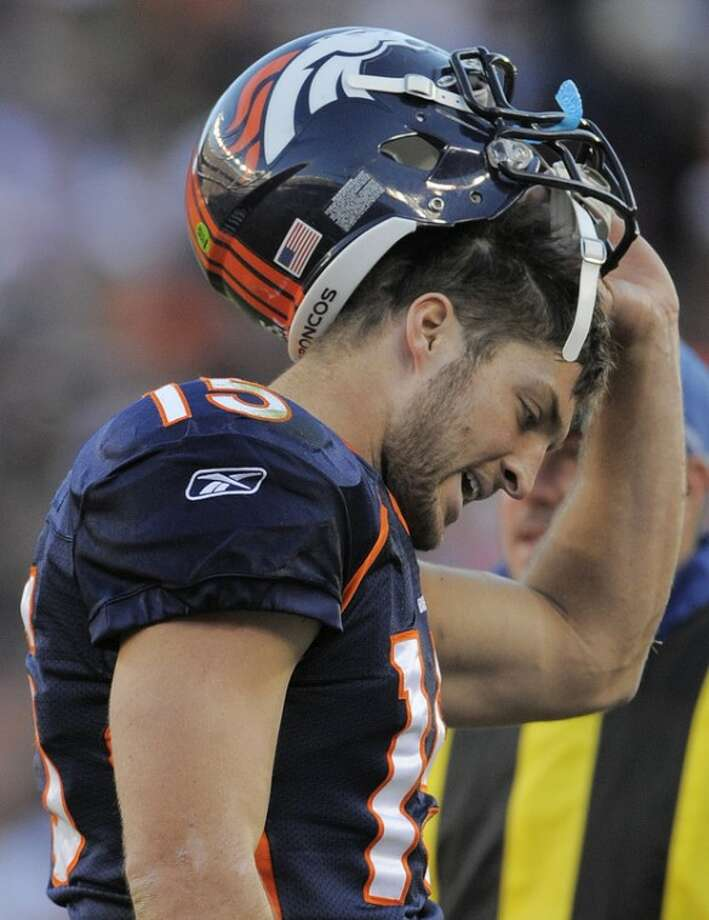 Denver Broncos quarterback Tim Tebow (15) walks off the field after fumbling the ball in the second quarter of an NFL football game against the New England Patriots, Sunday, Dec. 18, 2011, in Denver. (AP Photo/Jack Dempsey)