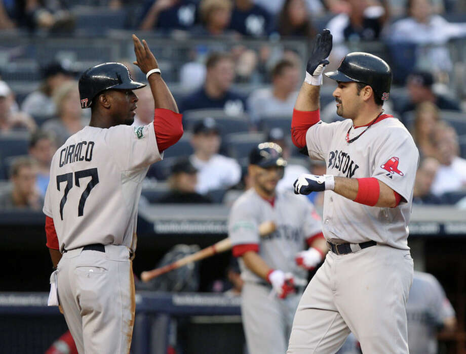Boston Red Sox's Adrian Gonzalez, right, is greeted by Pedro Ciriaco after hitting a three-run home run during the fifth inning of the baseball game against the New York Yankees at Yankee Stadium in New York, Saturday, July 28, 2012. (AP Photo/Seth Wenig) / AP