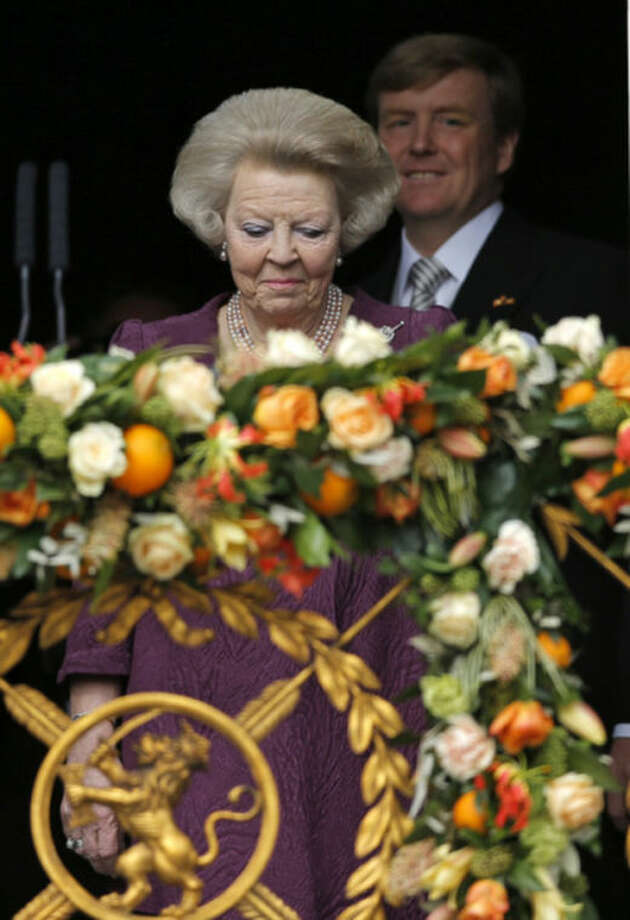 Dutch King Willem-Alexander follows his mother Princess Beatrix onto the balcony of the Royal Palace in Amsterdam, The Netherlands, Tuesday April 30, 2013. Around a million people are expected to descend on the Dutch capital for a huge street party to celebrate the first new Dutch monarch in 33 years. (AP Photo/Daniel Ochoa de Olza)