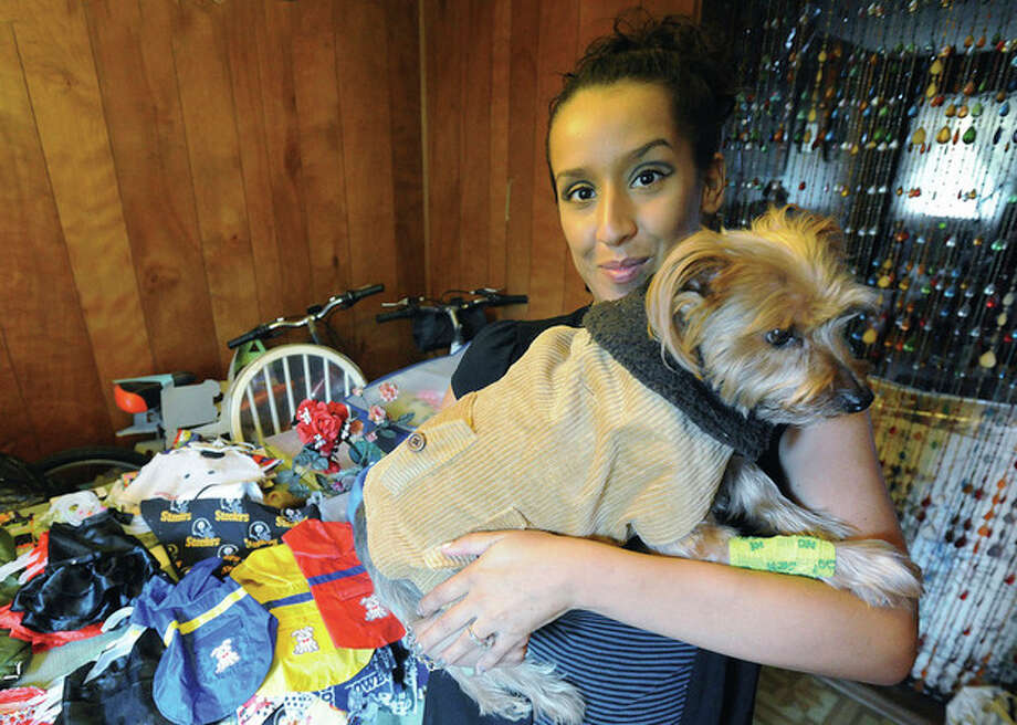 Hour photo / Matthew Vinci Wendy Humpries, owner of Woof Couture, makes clothes for cats and dogs. She plans to donate a portion of sale proceeds from Bark in the Park to PAWS.