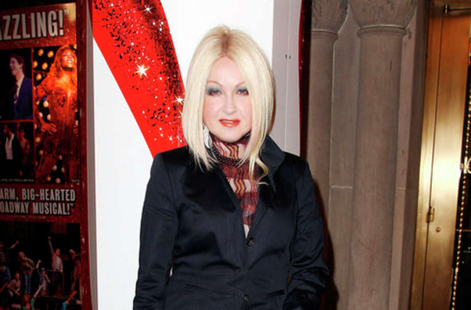 """This Feb. 28, 2013 photo released by Starpix shows, Cyndi Lauper at the open house for the Upcoming Musical """"Kinky Boots,"""" featuring Music by Cyndi Lauper, at the Al Hirshfeld Theatre in New York. The Cyndi Lauper-scored """"Kinky Boots"""" has earned a leading 13 Tony Award nominations, Tuesday, April 30, 2013. """"Kinky Boots"""" is based on the 2005 British movie about a real-life shoe factory that struggles until it finds new life in fetish footwear. Lauper's songs and a story by Harvey Fierstein have made it a crowd-pleaser. (AP Photo/Starpix, Kristina Bumphrey) / STARPIX"""