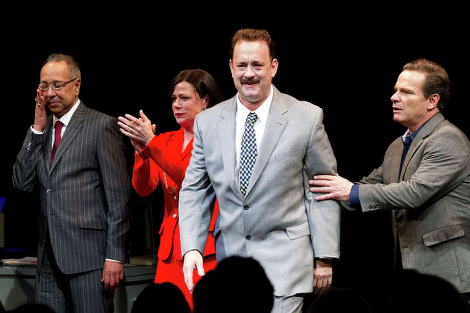 """This April 1, 2013 file photo shows, from left, George C. Wolfe, Maura Tierney, Tom Hanks and Peter Scolari at the Lucky Guy Opening Night, in New York. Hanks received a Tony nomination for best leading actor in a play, Tuesday, April 30, for his role in """"Lucky Guy."""" The awards will be broadcast on CBS from Radio City Music Hall on June 9. (Photo by Dario Cantatore/Invision/AP, file) / Invision"""