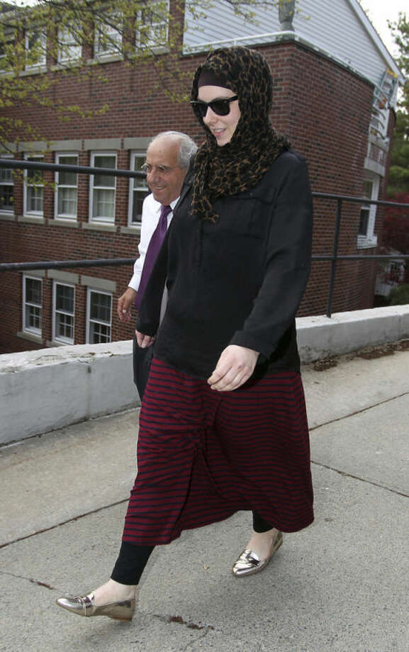 Katherine Russell, right, wife of Boston Marathon bomber suspect Tamerlan Tsarnaev, leaves the law office of DeLuca and Weizenbaum with Amato DeLuca, left, Monday, April 29, 2013, in Providence, R.I. (AP Photo/Stew Milne)