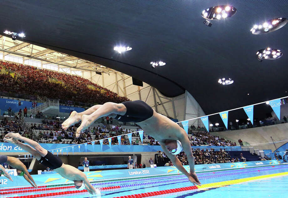 United States swimmer Ryan Lochte dives off of the starting block during the men's 400-meter individual medley event during the 2012 Summer Olympics at the Aquatics Centre in London on Saturday, July 28, 2012, in London. (AP Photo/Al Bello, Pool) / Pool Getty