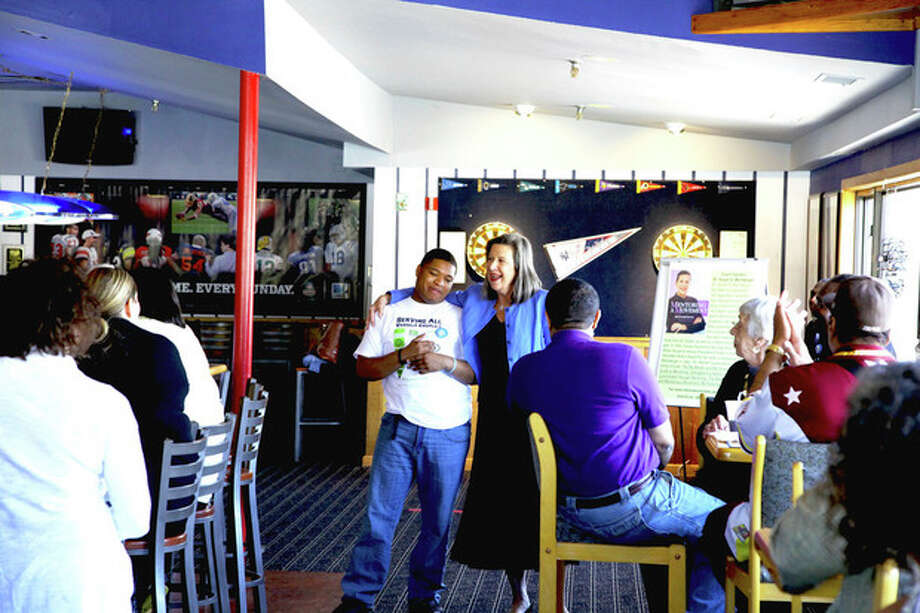 """Jayquan McKinney, one of the first participants of the S.A.V.E. mentoring program, shares his story and how having a mentor in his life for the past 10 years has made a difference during the """"Mentors & Mentees"""" fundraiser luncheon for S.A.V.E. hosted by the East Side Café Saturday."""