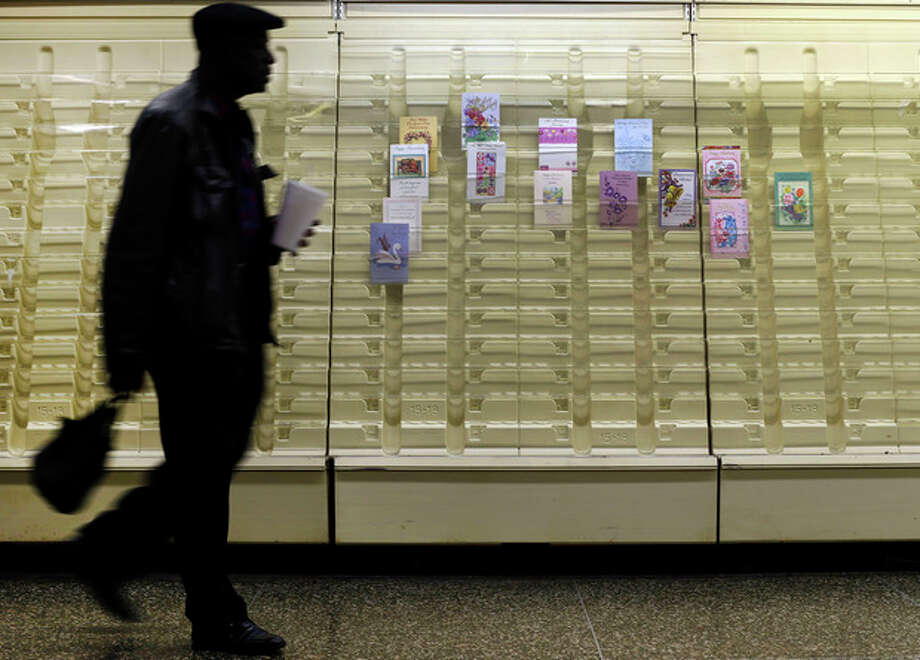 In this April 27, 2013 photo, a man walks past a greeting cards display case in a market in Baltimore.The private Conference Board reports on consumer confidence for April on Tuesday, April 30, 2013 (AP Photo/Patrick Semansky) / AP