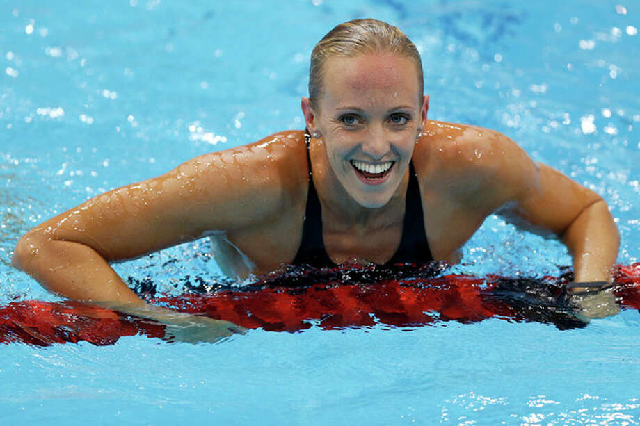 United States' Dana Vollmer reacts to her gold medal win in the he women's 100-meter butterfly swimming final at the Aquatics Centre in the Olympic Park during the 2012 Summer Olympics in London, Sunday, July 29, 2012. (AP Photo/Daniel Ochoa De Olza) / AP