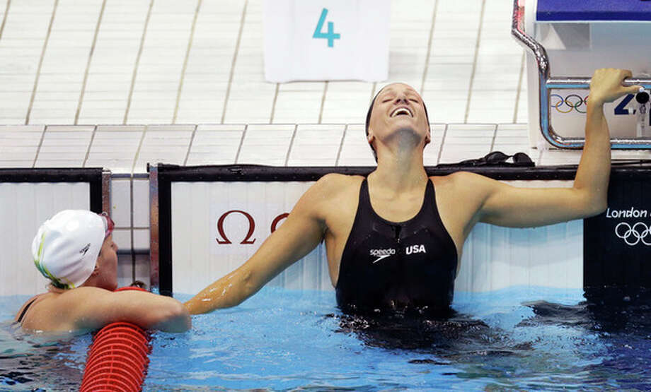 United States' Dana Vollmer, right, and Australia's Alicia Coutts react to Vollmer's gold medal win in the women's 100-meter butterfly swimming final at the Aquatics Centre in the Olympic Park during the 2012 Summer Olympics in London, Sunday, July 29, 2012.(AP Photo/Lee Jin-man) / AP