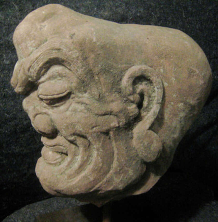 Contributed photo Thieves stole two ancient Chinese sculptures worth an estimated total of $1.6 million from a private Westport residence.