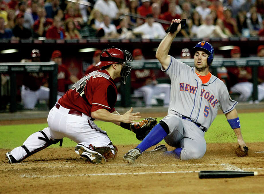 New York Mets David Wright, right, slides home safely in front of Arizona Diamondbacks catcher Miguel Montero in the fifth inning of a baseball game on Sunday, July 29, 2012, in Phoenix. (AP Photo/Rick Scuteri) / FR157181 AP
