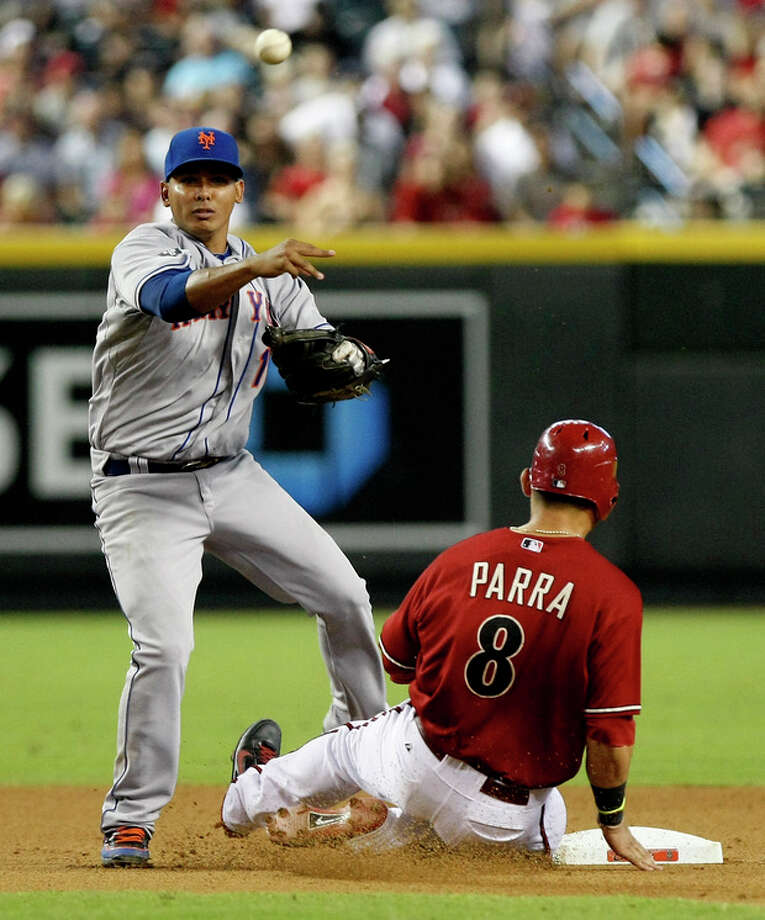 New York Mets shortstop Ruben Tejada, left, turns the double play while avoiding Arizona Diamondbacks Gerardo Parra in the seventh inning of a baseball game on Sunday, July 29, 2012, in Phoenix. (AP Photo/Rick Scuteri) / FR157181 AP